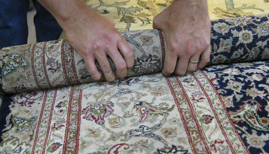 roll rugs tightly