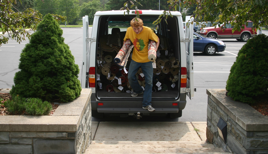 volunteers help unload